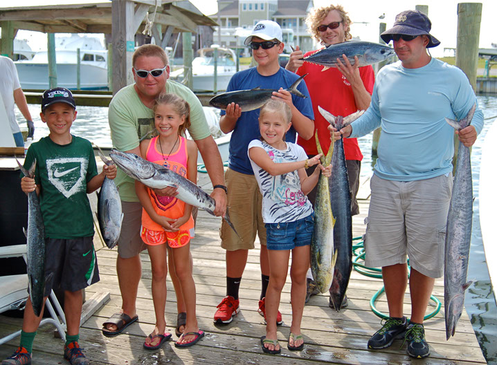 """Let's help show off this king mackerel, blackfin, barracuda, bluerunner, dolphin, wahoo and oceanic bonito catch.""   What a variety!"